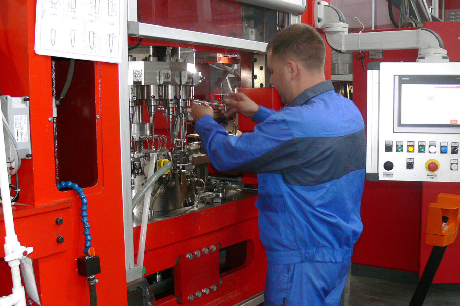 Worker setting up the press during the development of new products